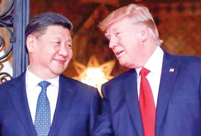 Tổng thống Mỹ Donald Trump và Chủ tịch Trung Quốc Tập Cận Bình trong lần gặp vào tháng 4/2017 tại khu nghỉ dưỡng Mar-a-Lago của ông Trump. Ảnh: Alex Brandon.