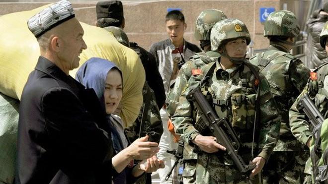 Trung Quốc siết chặt an ninh sau các vụ khủng bố ở Tân Cương (Nguồn: Kyodo/TTXVN)