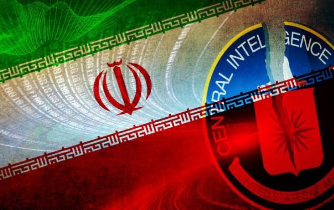 Hình cờ Iran và biểu tượng CIA. Ảnh: Yahoo.
