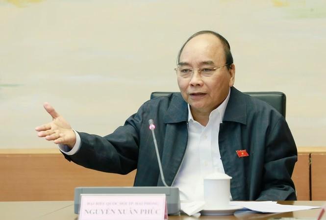 Thủ tướng Nguyễn Xuân Phúc phát biểu tại phiên họp tổ ngày 11/11. Ảnh Như Ý