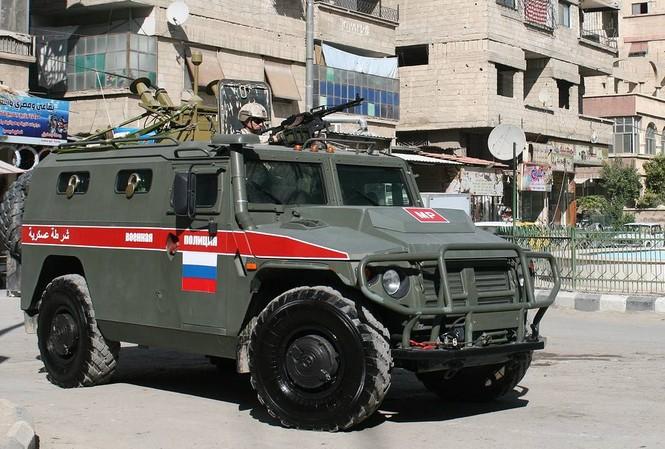 Xe của lực lượng vũ trang Nga. Ảnh: Tass