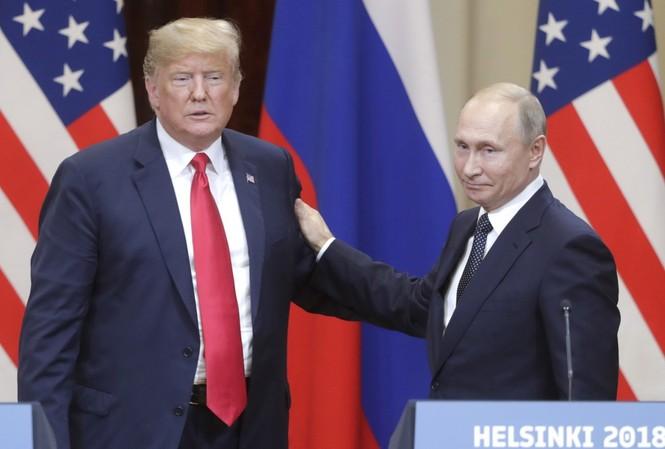 Tổng thống Nga Putin và Tổng thống Mỹ Trump. Ảnh: TNS