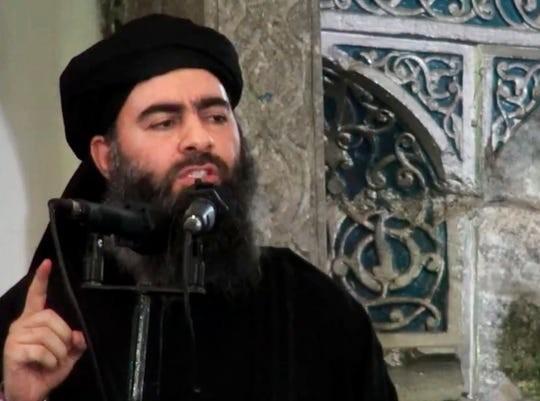 Hình ảnh thủ lĩnh IS Abu Bakr al-Baghdadi trong video đăng trên website của IS hôm 5/7/2014. Nguồn: AP.