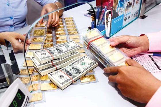 Giá vàng và USD bất ngờ tăng giá. ảnh minh hoạ