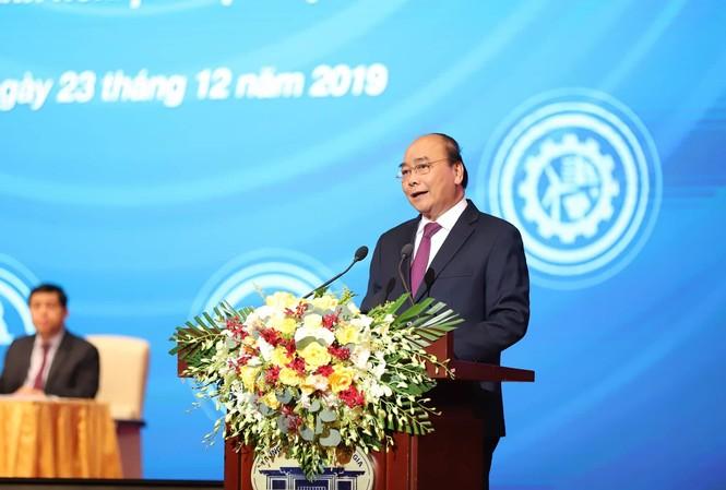 Thủ tướng Nguyễn Xuân Phúc đối thoại với DN. Ảnh Như Ý