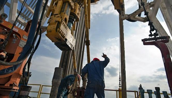 Mỹ có thể giảm sản lượng khai thác nếu giá dầu xuống 40 USD. Ảnh: Bloomberg.