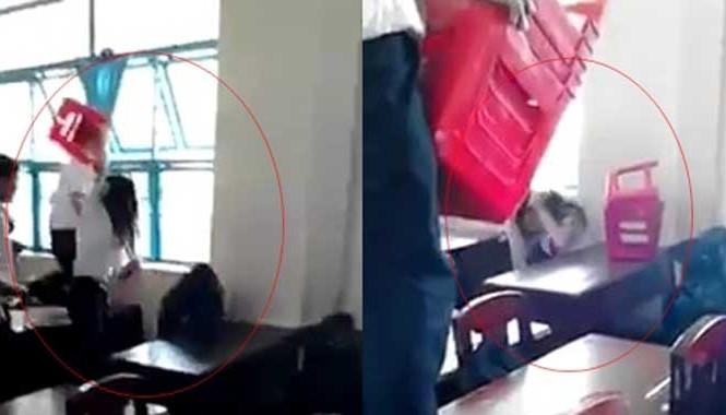 Nữ sinh bị bạn dùng ghế nhựa đánh hội đồng. Ảnh: Chụp màn hình.