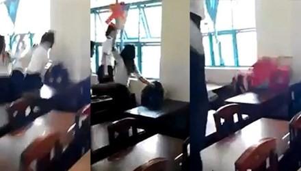 Nữ sinh lớp 7/5 bị đánh hội đồng. Ảnh cắt ra từ clip.