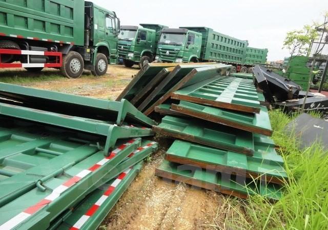 Hàng loạt xe tải cỡ lớn nhập khẩu với kết cấu thành thùng xe vượt quá cấp phép. Ảnh: Cục Đăng kiểm Việt Nam cung cấp.
