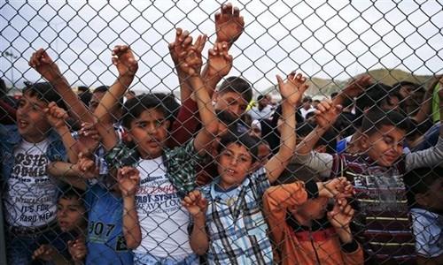 Trẻ em Syria tại trại tị nạn Nizip, Gaziantep, Thổ Nhĩ Kỳ, ngày 23/4. Ảnh: Reuters.