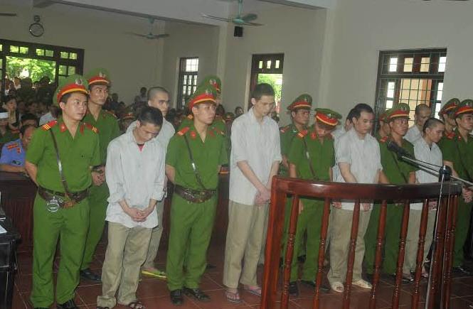 Các bị cáo tại phiên tòa ngày 13/7. Ảnh: Tuấn Nguyễn.
