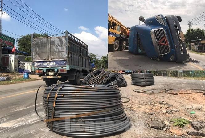 8 cuộn sắt lao từ container xuống đường đè bẹp xe máy đang lưu thông