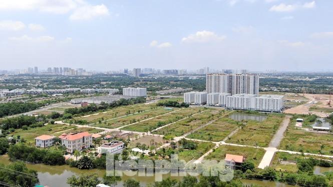 Giao Bộ Tài nguyên-Môi trường đánh giá loạt địa phương tăng giá đất - ảnh 1