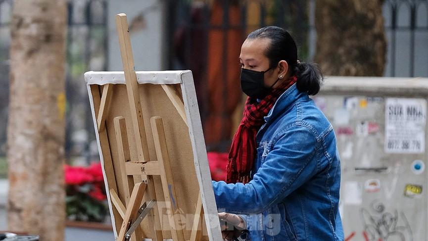 Khoảnh khắc Hà Nội vắng vẻ và bình yên sáng mùng 1 Tết Tân Sửu - ảnh 10