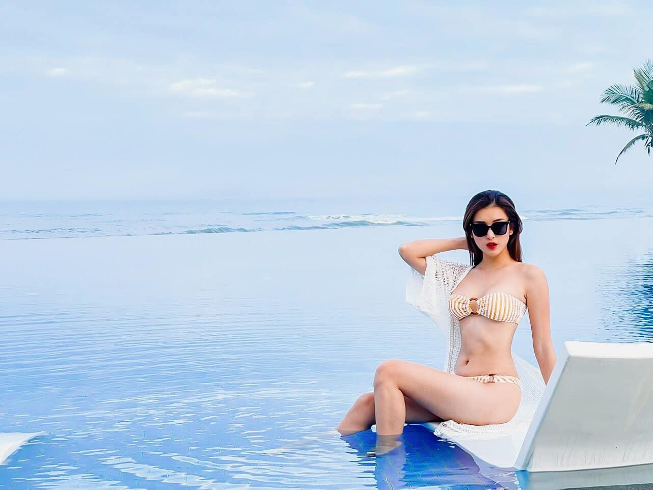 Hoa hậu Tiểu Vy mặc váy cô dâu khoe thềm ngực quyến rũ ảnh 10