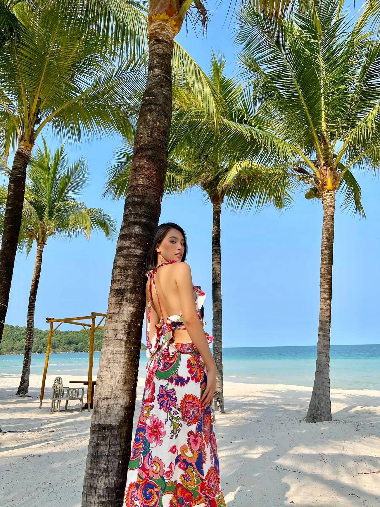 Đỗ Thị Hà đẹp lộng lẫy trong buổi chụp hình mới, Tiểu Vy khoe lưng trần sexy trước biển ảnh 7