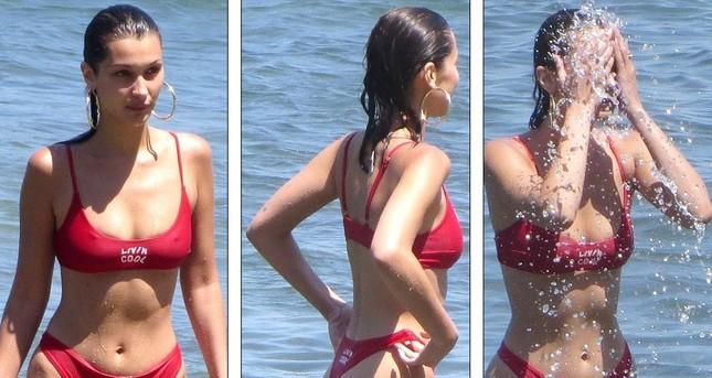 Bella Hadid diện bikini đỏ nóng bỏng hết cỡ tắm biển Malibu ảnh 1