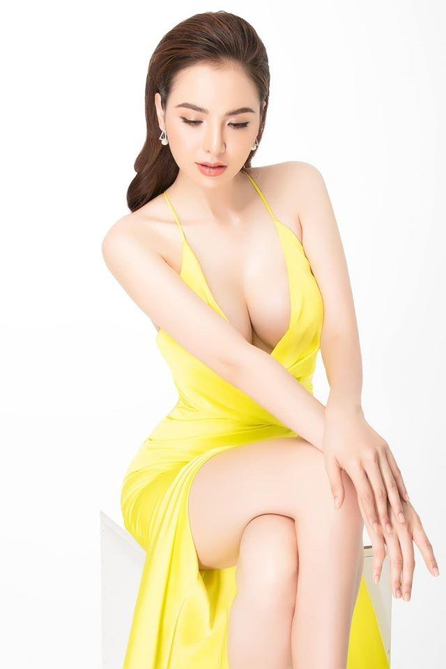 Hoa hậu Diễm Hương diện váy xẻ ngực sâu nóng bỏng ảnh 1