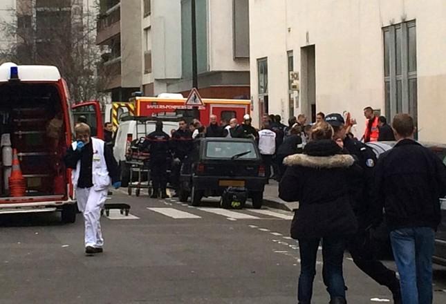 [ẢNH] Hiện trường vụ thảm sát kinh hoàng tòa báo ở Pháp ảnh 11