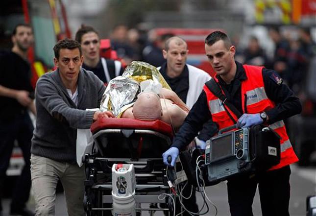 [ẢNH] Hiện trường vụ thảm sát kinh hoàng tòa báo ở Pháp ảnh 13