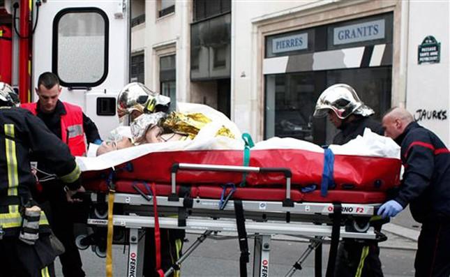 [ẢNH] Hiện trường vụ thảm sát kinh hoàng tòa báo ở Pháp ảnh 12