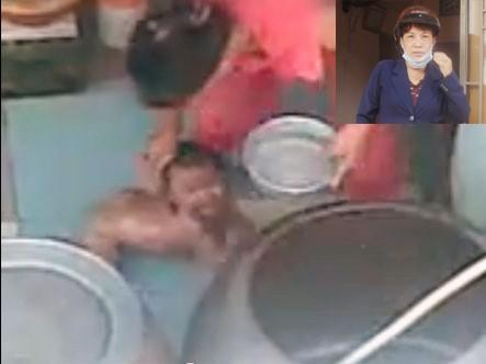 Bảo mẫu Phụng đang hành hạ bé Ngân (ảnh chụp từ video clip)