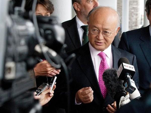 Tổng Giám đốc IAEA Amano sau khi gặp giới chức Iran từ Tehran trở về Vienna giữa các nhà báo Ảnh: IHT