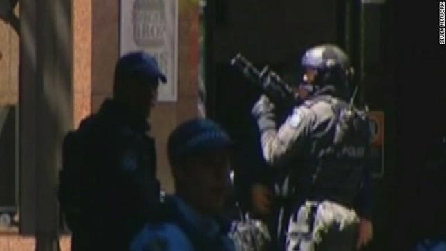 [ẢNH] Lính bắn tỉa bao vây kẻ bắt cóc con tin ở Sydney ảnh 12