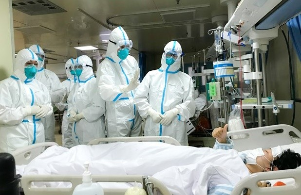 Nghi nhiễm Covid-19 đến đâu để được khám và điều trị? ảnh 1