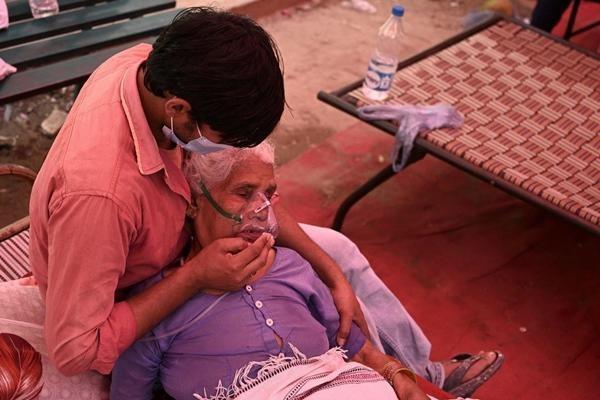 Ấn Độ vượt 20 triệu ca nhiễm: 120 người thiệt mạng mỗi giờ, kêu gọi phong tỏa toàn quốc ảnh 2