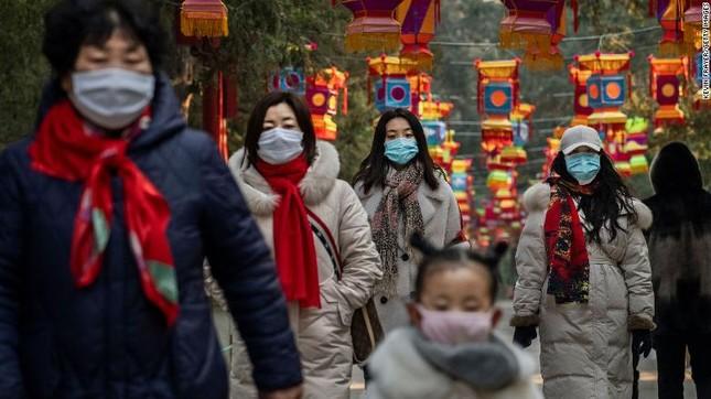 Trung Quốc nói coronavirus có thể lây trước khi người nhiễm có triệu chứng ảnh 1