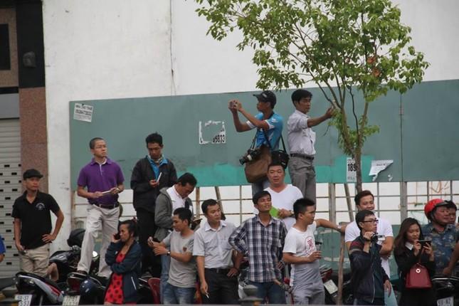Người dân TP HCM háo hức đón Tổng thống Obama ảnh 13