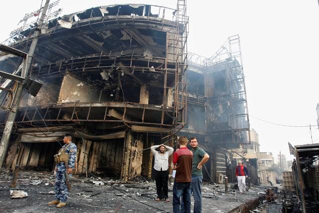 Hiện trường đánh bom đẫm máu khiến 125 người chết ảnh 11