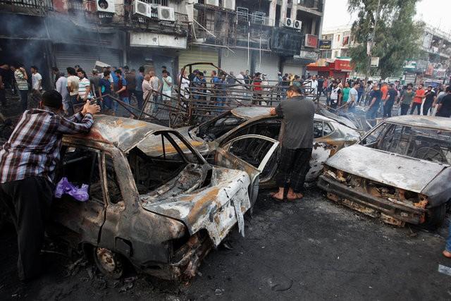 Hiện trường đánh bom đẫm máu khiến 125 người chết ảnh 12
