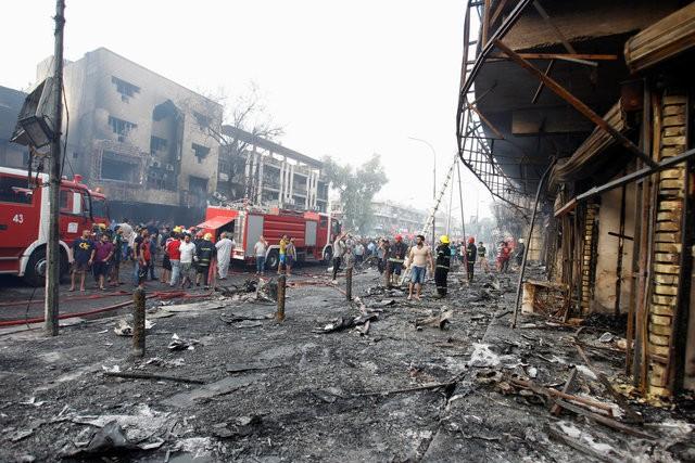 Hiện trường đánh bom đẫm máu khiến 125 người chết ảnh 13