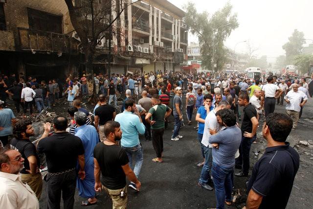 Hiện trường đánh bom đẫm máu khiến 125 người chết ảnh 14