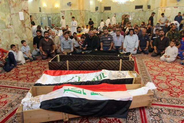 Hiện trường đánh bom đẫm máu khiến 125 người chết ảnh 15