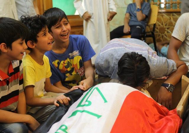 Hiện trường đánh bom đẫm máu khiến 125 người chết ảnh 16