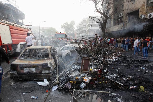 Hiện trường đánh bom đẫm máu khiến 125 người chết ảnh 6