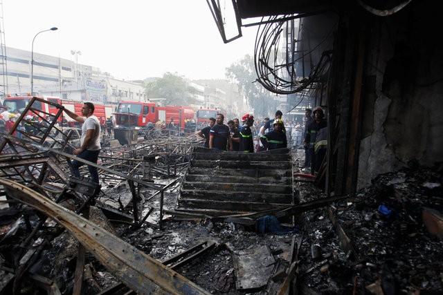 Hiện trường đánh bom đẫm máu khiến 125 người chết ảnh 8
