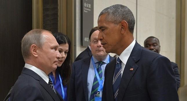 Những cuộc gặp đáng nhớ giữa ông Putin và ông Obama ảnh 7