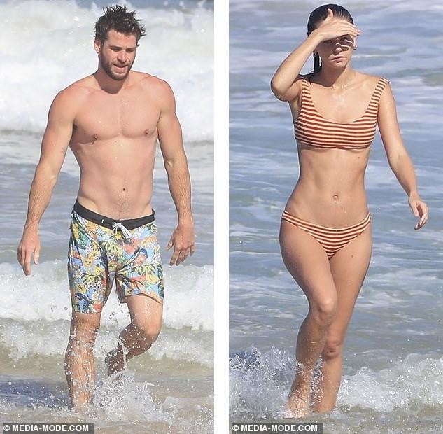 Liam Hemsworth hôn đắm đuối bạn gái người mẫu trên bãi biển ảnh 1