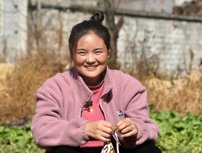 Người mẹ trong bức ảnh từng gây chấn động Trung Quốc 11 năm trước giờ ra sao? ảnh 2