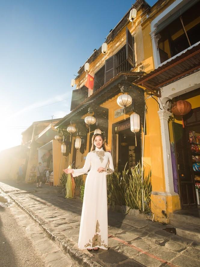 Thí sinh chung kết iMiss Thăng Long thả dáng trên phố Hội - ảnh 18