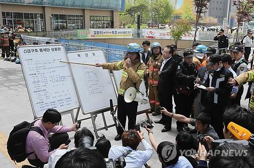 Cháy trung tâm mua sắm, 34 người thương vong - ảnh 1