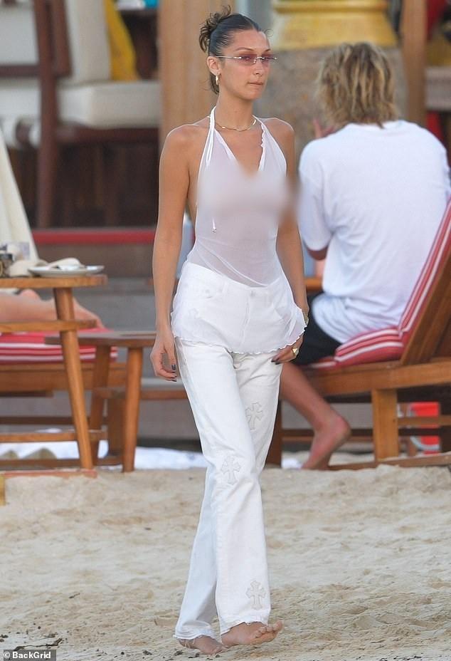 Bella Hadid áo xuyên thấu mỏng tang tạo dáng bên cây dừa - ảnh 4