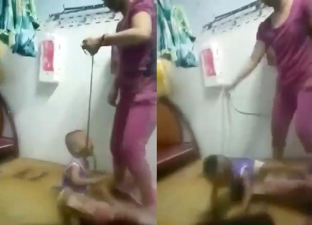 Tạm giữ người mẹ cột dây vào cổ con trai, bạo hành dã man - ảnh 1