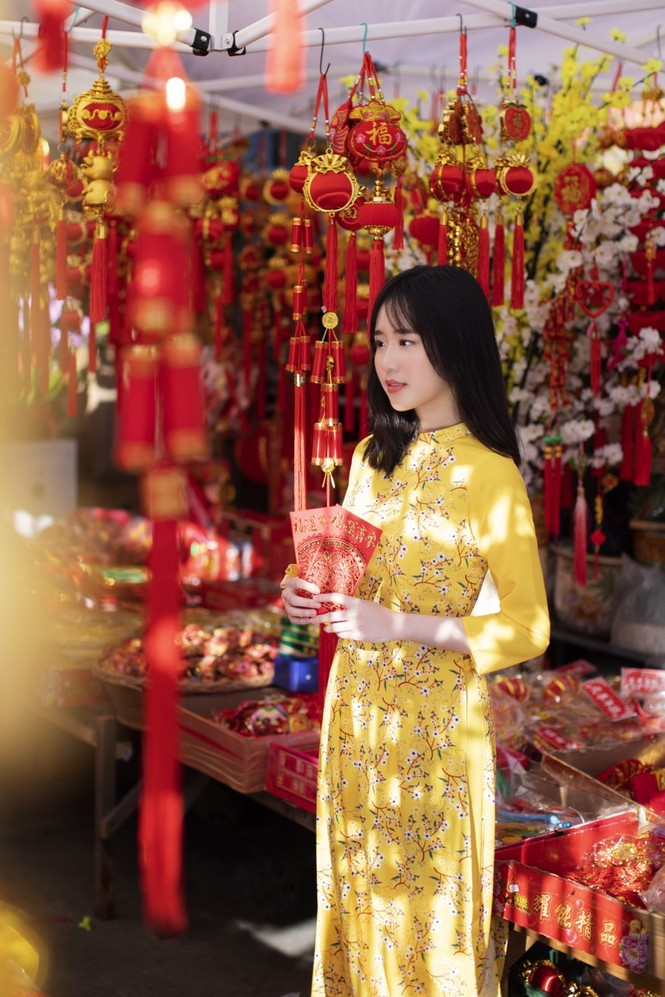 Rực rỡ sắc vàng với bộ ảnh áo dài Việt Nam đón Tết của du học sinh tại Mỹ - ảnh 10
