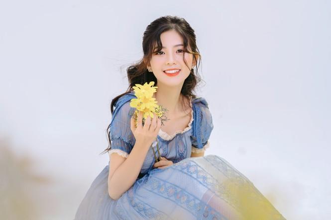 Nữ sinh điện ảnh gây ấn tượng bởi bộ ảnh Tết bên áo Tấc Việt phục - ảnh 11
