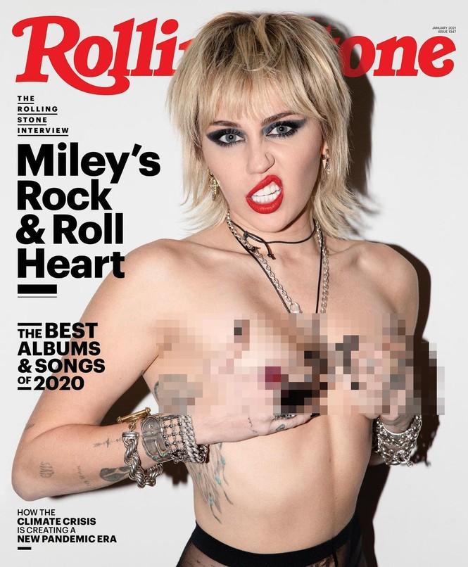 Miley Cyrus phô ngực trần táo bạo trên tạp chí - ảnh 1